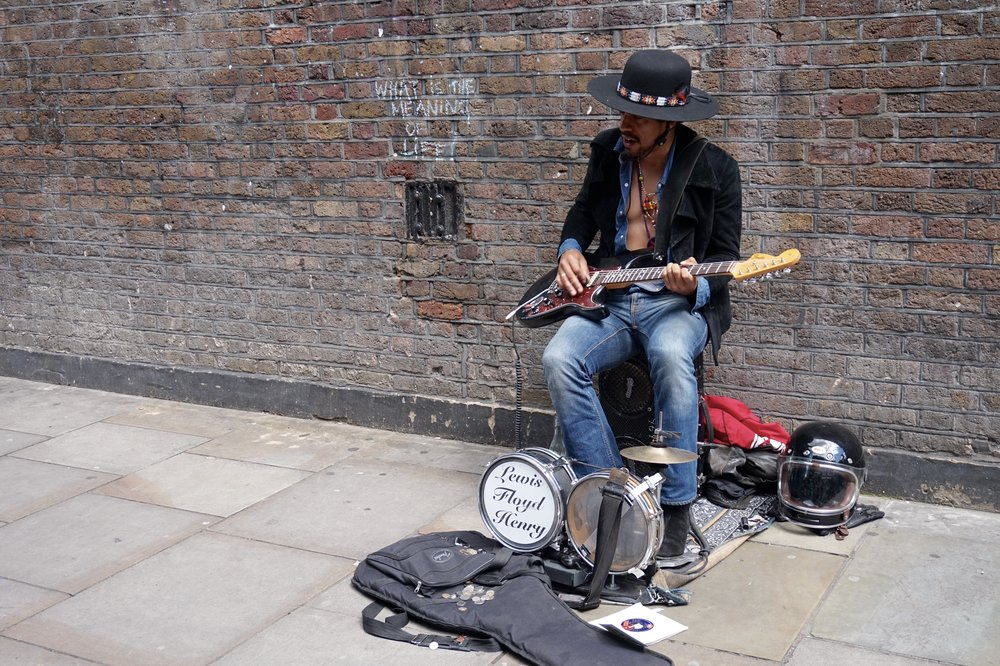 Buskers along the streets of Brick Lane