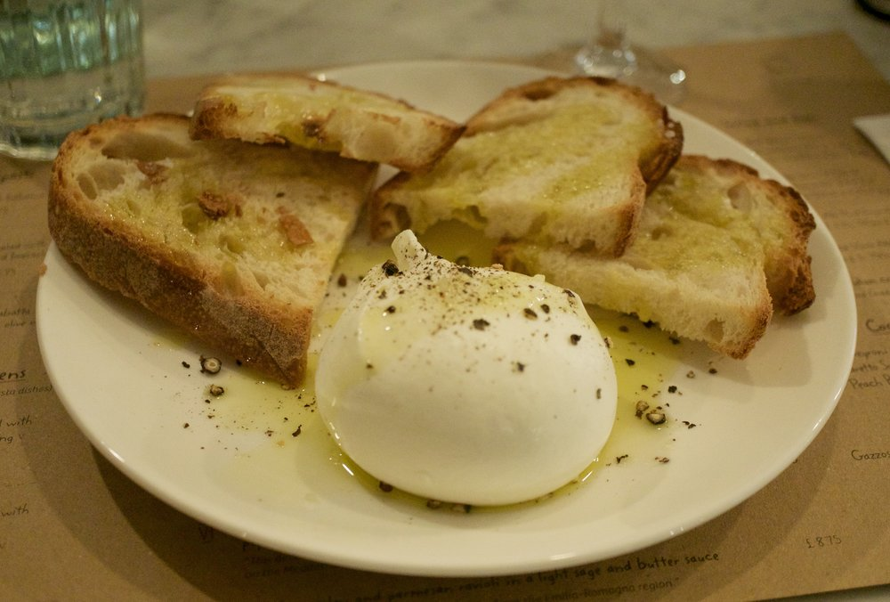 Burrata with toasted cibatta and a drizzle of olive oil
